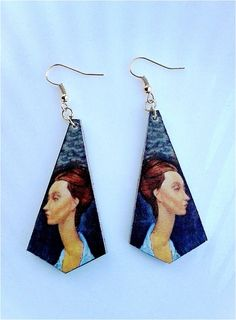 """Earrings by lobo in a lightweight yet durable plastic material, finished by hand, with image of a famous """"long neck"""" portrait of the painter Modigliani, finishing with edges and back in solid gold.  height: 5.5 cm, thickness: 2 mm   Shop this product here: spreesy.com/DifferentsEarrings/4   Shop all of our products at http://spreesy.com/DifferentsEarrings      Pinterest selling powered by Spreesy.com"""