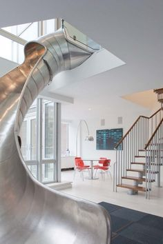 never mind the resemblance to a vaginal speculum or some other bizarre medical equipment, much more than a children's slide -- the concept is brilliant, though it doesn't eliminate the need for a stair.