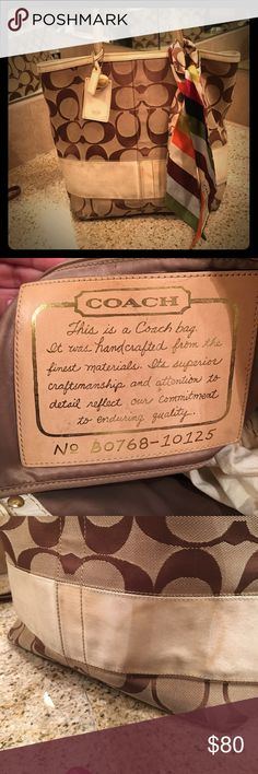 Coach Tote Much loved Coach Tote in brown and vanilla. Needs a good cleaning but still in good shape. Selling it with silk Coach scarf Coach Bags Totes