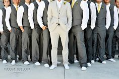 You don't wear the same dress as your bridesmaids, why should the groom look the same as his groomsmen.  It's his day too and he should stand out. Whether its a different color suit, a different color vest, or he wears a jacket. Cute!