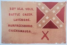 Second National Flag used as a Battle Flag of the 32nd Alabama Infantry. The flag has Battle Honors, including a crossed cannon signifying the regiment captured an enemy artillery piece. A few weeks after the Battle of Chickamauga, the 32nd consolidated with the 58th Alabama and the consolidated regiment used the 58th's battle flag with a 32 added before the 58th Regt ALA VOLS. Old South Military Antiques.