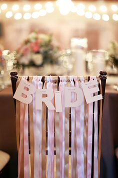ribbon chair decor and wedding sign ideas for bride and groom