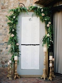 large wedding placement cards sign covered with greenery and roses http://itgirlweddings.com/fairy-tale-wedding/