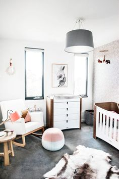 Stunning modern nursery featuring These Walls dot wallpaper, Lumiere Art and Co artwork, Vulu cot and beautiful bedding textiles. See more from stylist Aimee Tarulli's home on the blog now...