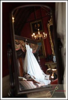 Reflection of a beautiful wedding dress at Maunsel House in Somerset