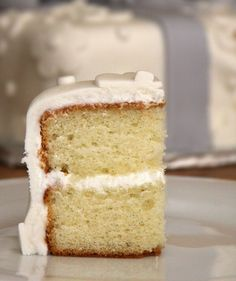 Vanilla Bean Cake  3 cups cake flour 1 Tbsp baking powder 1/2 tsp salt 1 vanilla bean, split and scraped 1 cup unsalted butter, cubed and softened to room temperature 2 cups sugar 5 large eggs, at room temp 1 1/4 cups buttermilk, at room temp 2 tsp-1 Tbsp vanilla