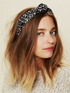 This medium length hairstyle is lovely with a subtle ombre and a knotted headband.