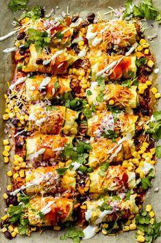 Zucchini Chicken Enchiladas made in a sheet pan and zucchini instead of tortillas. #enchiladas #chickenenchiladas #lowcarbchicken #lowcarbmeals #zucchinienchiladas #zucchinichicken