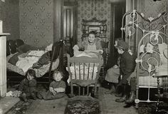 TENEMENT LIFE: Living rooms in crowded tenements, 1910.