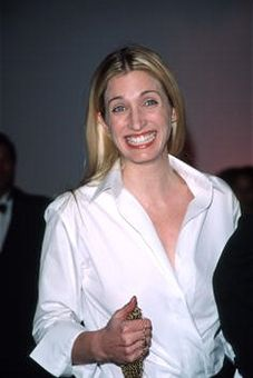 Carolyn Bessette Kennedy poses for a picture at the Annual Fundraising Gala March 9, 1999 at the Whitney Museum of American Art in New York City. It is also the kick-off event for the museum's new exhibition entitled ''The American Century: Art and Culture 1900-2000.''
