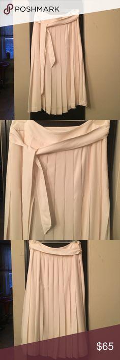 Cream Pleated Banana Republic Skirt Brand new. Never worn. 100% polyester. Below the knee. Midi skirt. Beautiful for a night out Banana Republic Skirts Midi