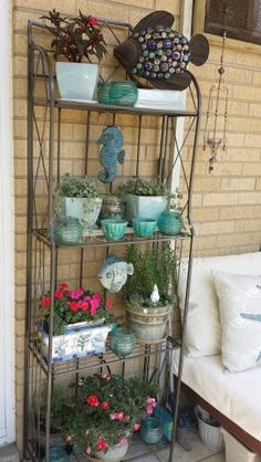 A Baker's rack was used to efficiently and elegantly house this container garden.