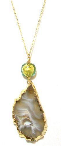 Second Glance Designs Goldtone Natural Druzy Pendant Necklace with Venetian Glass Second Glance Designs. $49.95. Gorgeous natural druzy pendant on goldtone link chain with Venetian glass accent bead. Necklace is 20 inches long with a spring ring clasp. Natural, neutral druzy in wonderful shades of tan, brown, white and black. Venetian glass accent bead in faintest aqua blue with gold foil inside. Druzy pendant shapes and sizes vary naturally