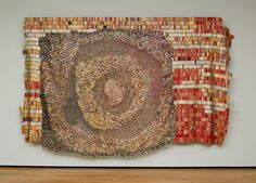Dzesi II,2006  by Emmanuel Kwami Anatsui made of aluminum liquor bottle caps and copper wire at Akron Art Museum.  An exhibit of his works is coming to Akron this summer.