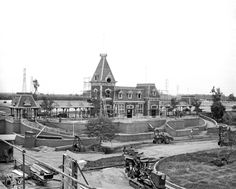 "A very rare photo of the construction of the Main Street Station, the popular starting point of your ""grand circle tour"" aboard the vintage trains of the Disneyland Railroad."