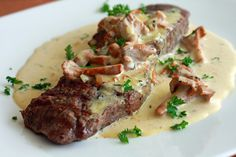 Steak With Creamy Chanterelle Sauce  Ingredients    4 8oz top sirloin, New York, or Rib eye steaks  Salt and pepper  Sauce:  6 oz chanterelle mushrooms  1 tbs butter  2 tbs finely minced shallots  2 cloves garlic, minced  ¼ cup white wine  1 cup heavy cream  ¼ tsp dried thyme  ½ tsp cracked black peppercorns  1 tsp chicken bouillon granules  Fresh parsley for garnish