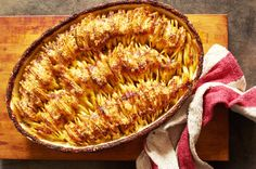 NYT Cooking: Cheesy Hasselback Potato Gratin potatoes fell in pan a bit as they cooked and shrunk in size so didn't have as much crunchy texture as had hoped Potato Dishes, Potato Recipes, New Recipes, Cooking Recipes, Favorite Recipes, Most Popular Recipes, Hasselback Potatoes, Sliced Potatoes, Cheesy Potatoes