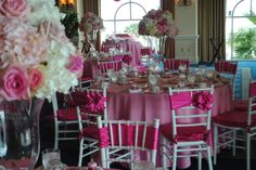 pink satin chair bows, white Chiavari chairs, white and pink hydrangea and rose centerpieces in glass urns. Perfect baby shower or bridal shower color palette.