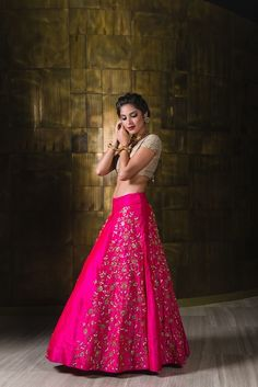 cream and hot pink lehenga, scattered motifs, silver motif on sides, plated embroidery