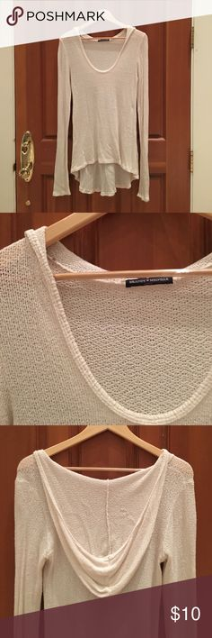 Hooded Ivory slouchy and cozy sweater Slouchy sweater that will go great with leggings, jeans or shorts. It's a great layering piece for fall and winter and a great summer throw over. Only worn a few times! Brandy Melville Sweaters Crew & Scoop Necks