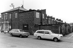 1979 compulsory purchase list.Black and white photograph showing the rear elevations of terraced properties Numbers 17-47 Morley Street, St.Helens.The property at the corner of Morley Street and Cooper Street was M. Mawdsley Newsagent's shop