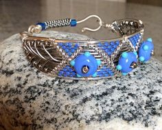 Bracelet  inspired by Lisa Barth.   Silver plated copper with lamp-work  beads.    I once wove with yarn but as I got  older found it too tedious (too many steps).  Now I get the same satisfaction when I complete a wire woven piece,