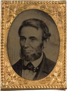 """Gem size badge with Ferrotype portrait of Lincoln known as the """"Speed"""" portrait. Lincoln received a Bible from Joshua Speed's mother and the President later reciprocated the gift with an inscribed photo to her. Portrait was taken in 1861, however, this badge is most likely made to use for 1864 Presidential Campaign. (Speed was one of Lincoln's closest early day friends in his Springfield years and they were partners in a General Store). *s*"""