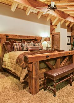 This master bedroom suite encompasses the entire second level of this California log home, which emphasizes an open, airy feeling everywhere. LED lights along the ridge beam add warmth, as does the intimate fireplace.
