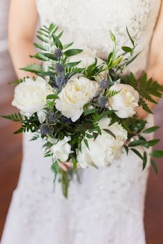 blue thistle, fern + add salal and salal berries and maybe blush pink garden roses or peonies instead of the white flower