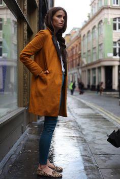 Burnt orange coat and leopard shoes.
