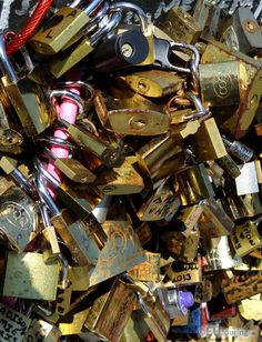In this photo you can see some of the many love locks which have been attached to the Pont de l'Archeveche, which is also known as the Lovers Bridge, where many couples have gone there to place their own.  You may also like www.eutouring.com/images_pont_de_l_archeveche.html