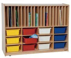 WOOD DESIGNS  Tip-Me-Not™ Portfolio Storage with Twelve Assorted Trays.    GREENGUARD® Gold certified. Tip-Me-Not™ design provides additional classroom safety. Versatile divided storage areas for puzzles, games, and books, plus a generous storage area includes twelve color rectangular tote trays. All surfaces and back are 100% Healthy Kids™ Plywood with our exclusive Tuff-Gloss™ UV finish. Fully assembled on casters. Lifetime warranty.
