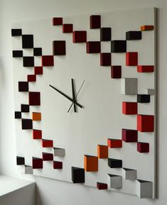 Deco Angle Red   Liliana Stoica tridimensional wood wall clock To work with a material as wood, to give it geometrical shapes, its like telling a story. A story without words, which starts from pure passion for volumes and colors. Perfectly integrated and portioned, this three elements