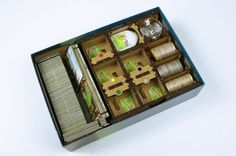Unique game organizer for ISLE OF SKYE board game