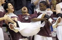 The Montana Grizzlies bench celebrates the team's win over Weber State, and Big Sky Conference championship. TOM BAUER/Missoulian http://missoulian.com/sports/college/montana/mens-basketball/griz-win-big-sky-championship-earn-trip-to-big-dance/article_1feb262c-68ca-11e1-8644-0019bb2963f4.html