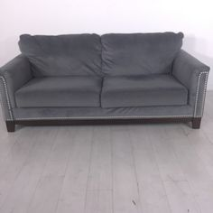 Heather Gray Sofa. - Classic styled sofa- Features metal riveting- Very soft and plush- Good condition
