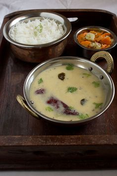 Gujarati Kadhi - yoghurt based raso dish to which chickpea flour is added and tempered and them simmered with Indian spices Gujarati Cuisine, Gujarati Recipes, Indian Food Recipes, Gujarati Food, Rajasthani Recipes, Indian Snacks, Vegetarian Curry, Vegetarian Recipes, Cooking Recipes