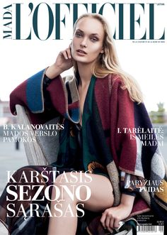 A Burberry Prorsum runway blanket poncho on the cover of the September 2014 issue of L'Officiel Lithuania