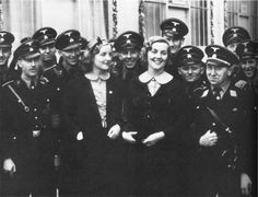 Unity Mitford (left) and her sister, Lady Diana Mosely, with members of Hitler's SS troops at the September, 1937, Nurembergy Nazi Party rally.