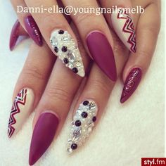 Mauve stiletto nails with gemstones