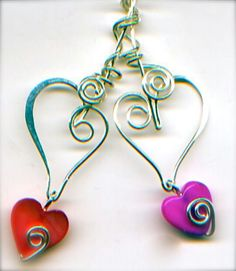 Two wire hearts combine together into a pendant
