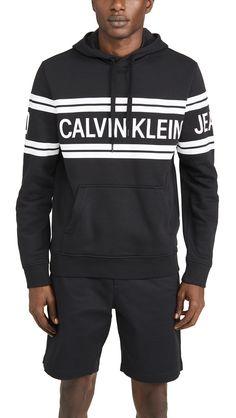 Calvin Klein Jeans Varsity Traveling Logo Crossover Hoodie In Black Calvin Klein Jeans, Black Hoodie, Crossover, Hooded Jacket, Traveling, Hoodies, Logo, Long Sleeve, Sleeves