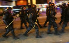 Atlanta police in riot gear help keep protesters moving down Peachtree Street in Atlanta in the wake of the grand jury decision not to indict officer Darren Wilson in the shooting death of Ferguson, MO., teen Michael Brown. CURTIS COMPTON / CCOMPTON@AJC.COM