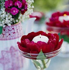 red flowers and white candles centerpieces