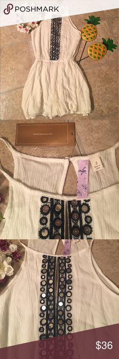 "New Francesca's ivory sequined high neck romper New Francesca's ivory sequined high neck romper. Size small but has elastic band at waist. Shorts part is flowy and loose. Perfect for hot summer days 🌞🌊🌴Super cute and  on trend!! 100% rayon lining inside and 100% polyester outside. Bust measures 17"" across, waist is 11""-13"" because of stretch and inseam is 14"" ASOS Shorts"