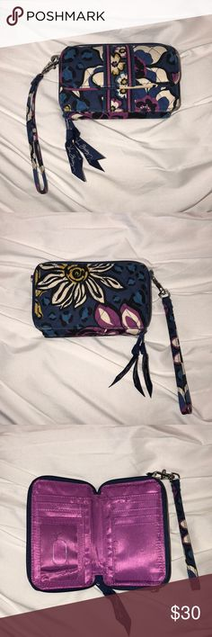 "Vera Bradley ""All in One"" Wristlet/Crossbody Vera Bradley wallet wristlet, can also be used crossbody. Contains two separate wallet compartments and outer phone holder. Pattern is in African Violet. Like-New condition, minor wear and tear. Smoke-free home. Offers welcomed!! Vera Bradley Bags Clutches & Wristlets"