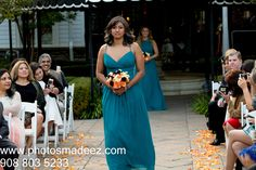 Bridesmaid walking down the aisle at Fusion Wedding at eagle Oaks Golf and Country Club. Best Wedding Photographer PhotosMadeEz. Award Winning Photographer Mou Mukherjee. Along with Abhishek Decor and event coodrinated by Social Life Events #reddy4ever - Candid moment. Photo Journalism