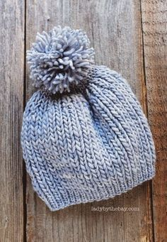 """Knitted hat. 110 yards of worsted (4) yarn. Size US9 (5.5mm) 16"""" circular needles, size US13 (9mm) 16"""" circular needles, and size US13 double pointed needles."""