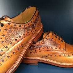 Paisly print tattoos on tan brogue shoes