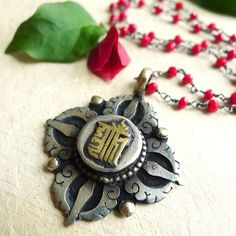 Coral Rosary Necklace with Kalachakra Pendant by 137point5